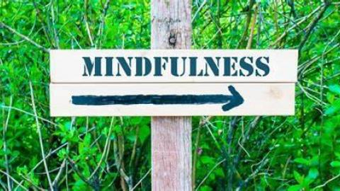 Photograph of the word Mindfulness on a post.